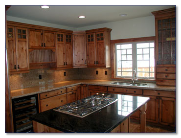Knotty Cherry Cabinets http://www.markimconstruction.com/kitchens.asp